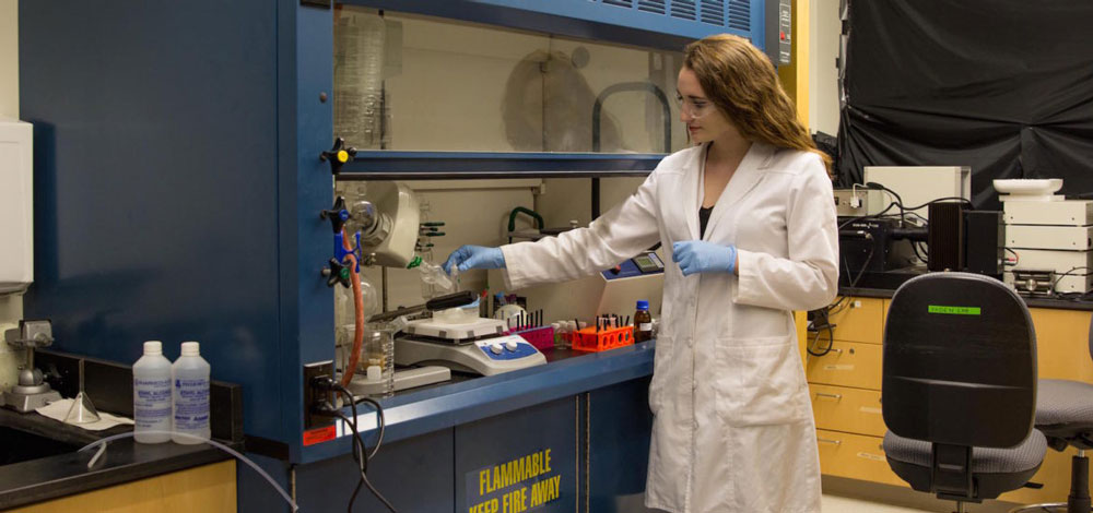 Kelsey working inside one of Engineering Halls labs